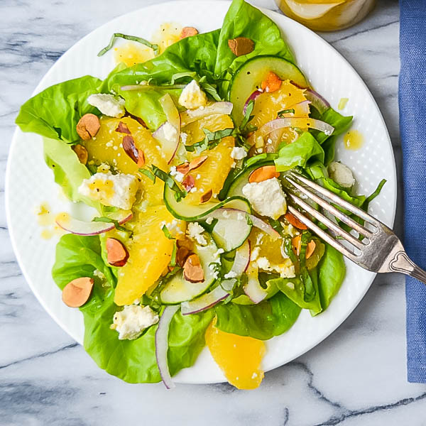 Simple Citrus Almond Salad on a plate with fork