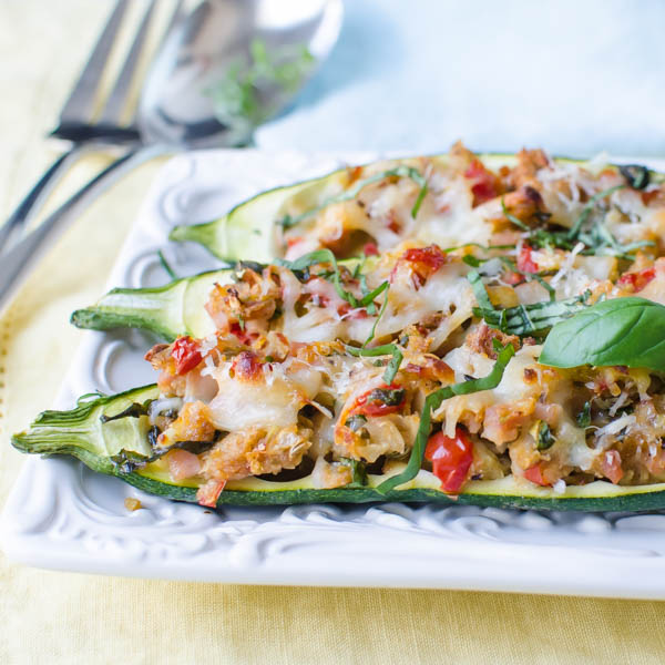 Stuffed Italian Zucchini Boats with slivered basil.