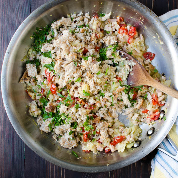 saute vegetable filling and add breadcrumbs in a skillet.