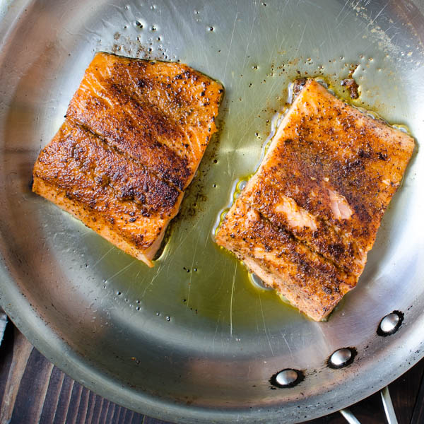searing salmon in a pan