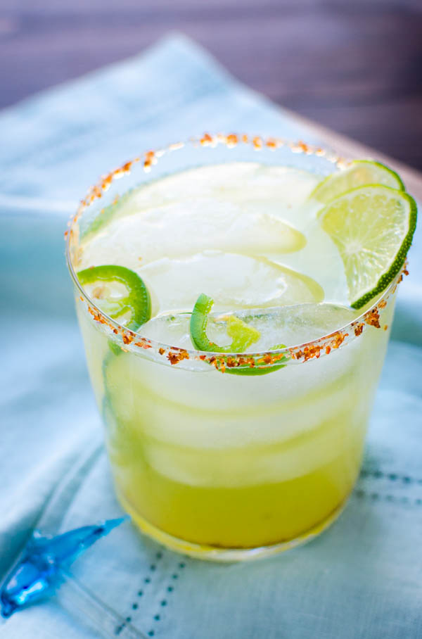 Spicy Margarita Recipe in a glass with lime and jalapeno slices.
