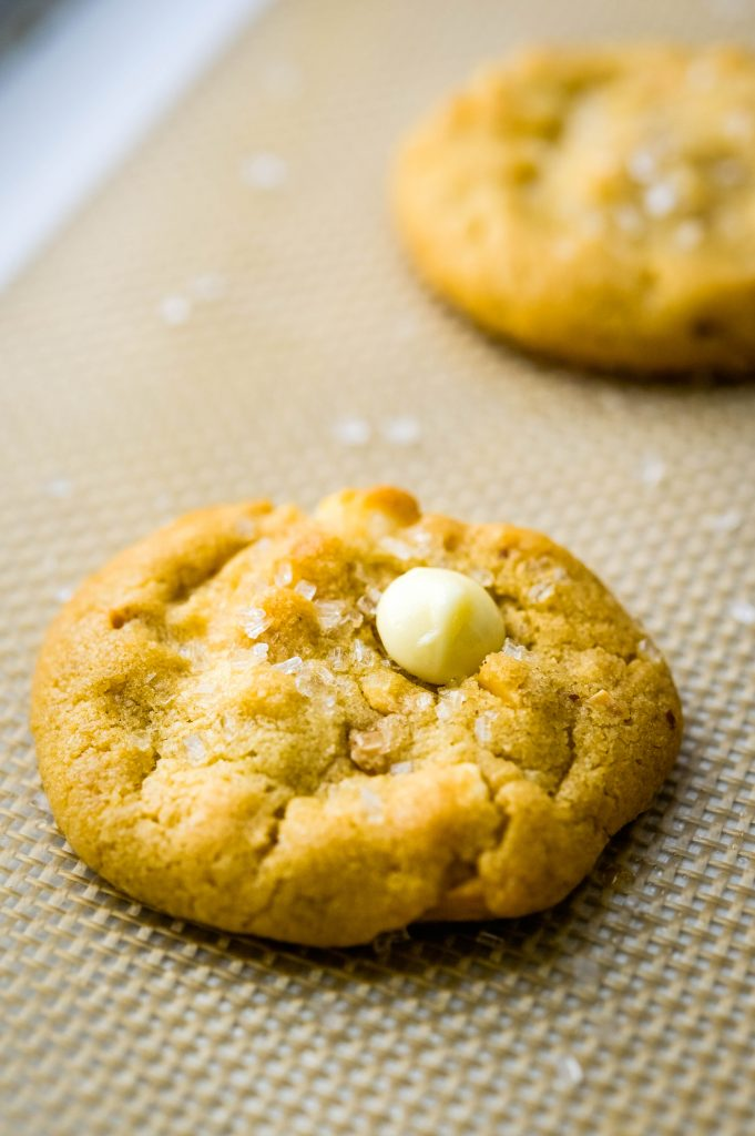 a mini baked chunky peanut butter cookie on a silpat.