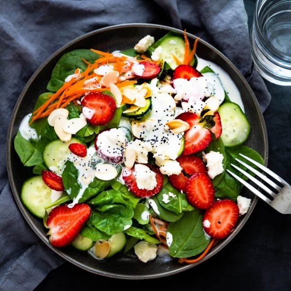 spinach strawberry salad on a plate.