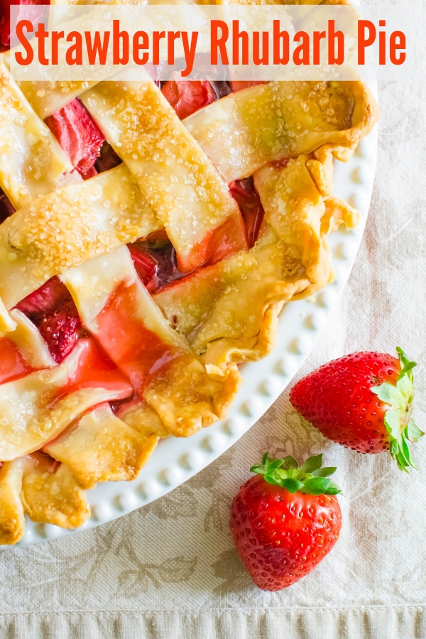 This classic Old Fashioned Strawberry Rhubarb Pie is always a hit with the family. Use this secret ingredient to prevent watery, gooey filling. #strawberrypie #rhubarbpie #springdesserts