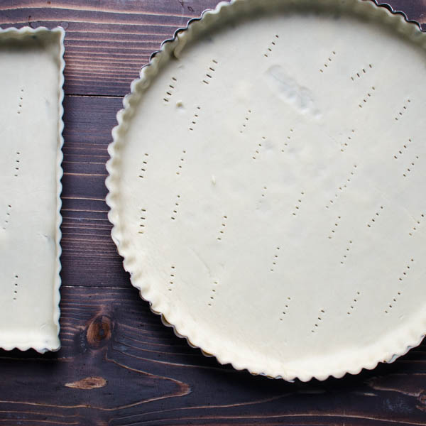 fitting crust into tart pans.