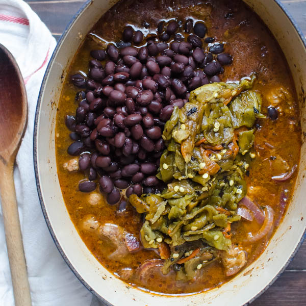 adding chiles and black beans to stew