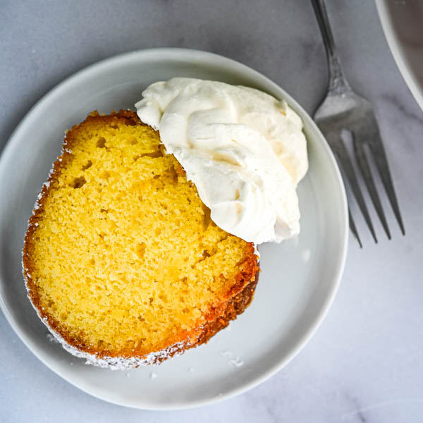 A slice of Rum bundt cake with a dollop of whipped cream makes this elegant and delicious.