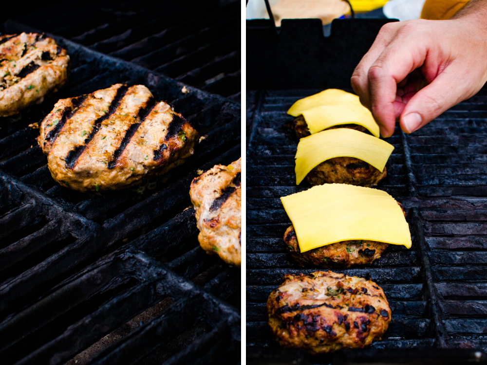 grilling the burgers and topping with cheese.