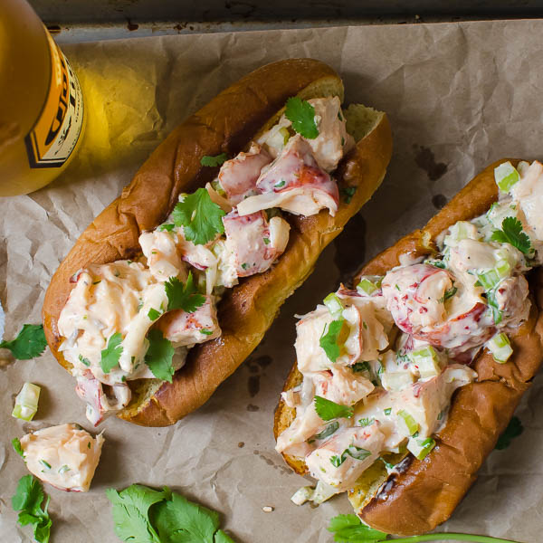 Sriracha Lobster Rolls with a beer