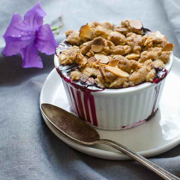 Blueberry Lemon Almond Crisp with a spoon.