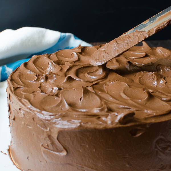 swirling frosting on Double Chocolate Layer Cake