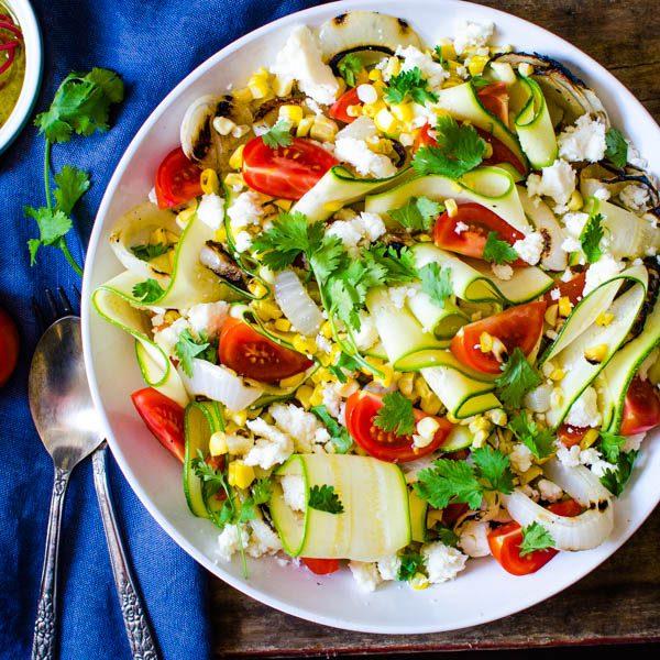 veggie salad with sprigs of cilantro