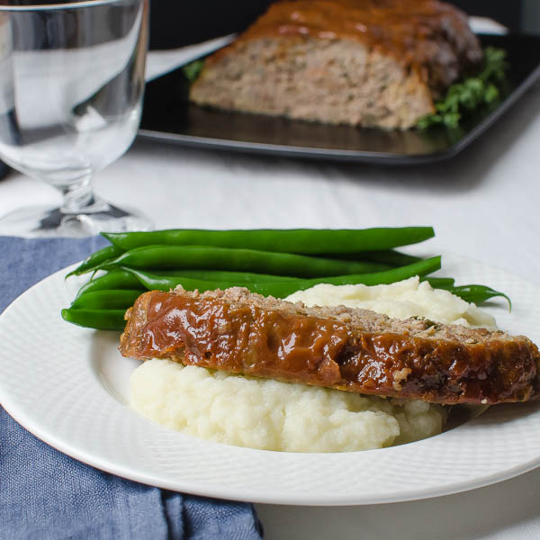Savory Homestyle Meatloaf over mashed potatoes