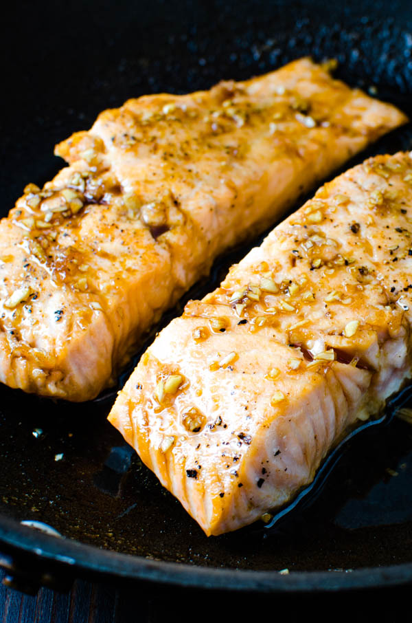 pan searing the glazed salmon.