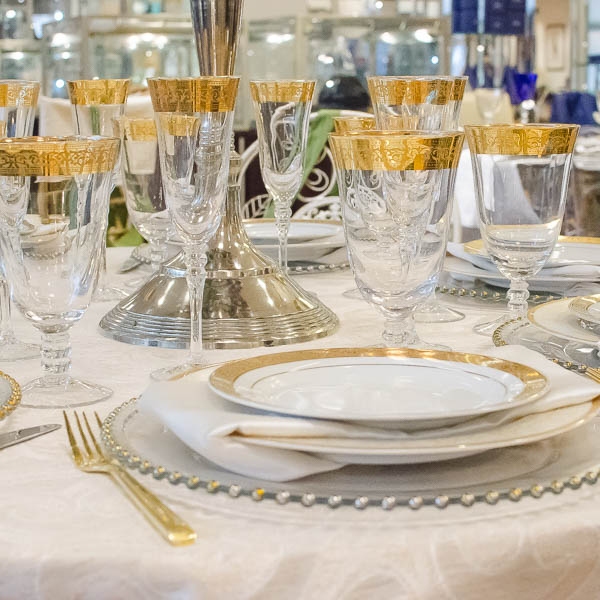 Gild the lily with this table setting of gold trimmed china, crystal and flatware!
