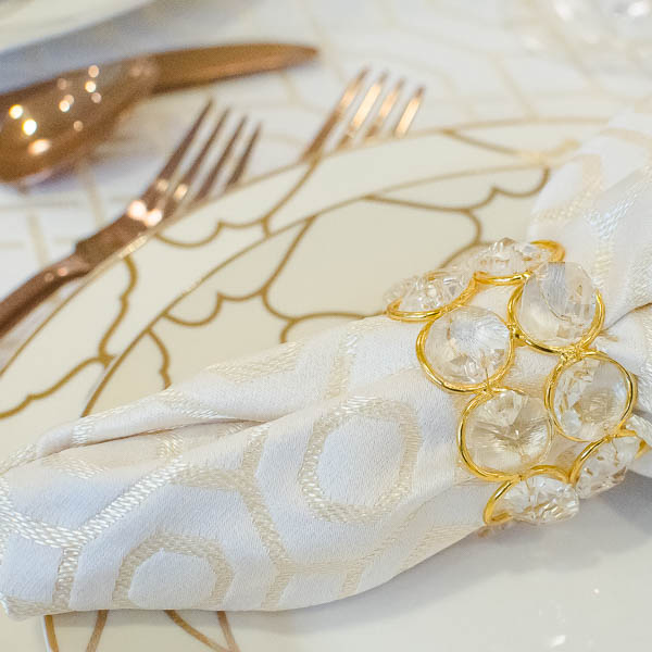 Mixing metals is BIG this year, and I love the shimmer of the napkin rings with the coppery flatware!