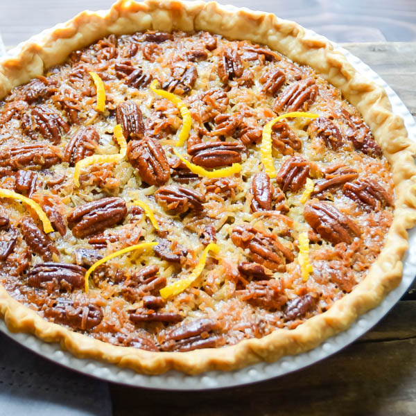 Orange Coconut Pecan Pie with orange peel.