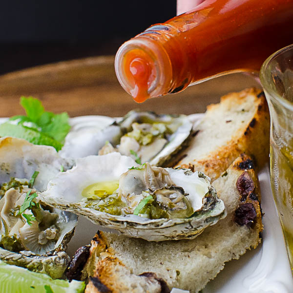 Citrusy Grilled Oysters with hot sauce