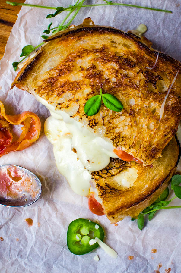 Crispy Pancetta Guava Grilled Cheese on a cutting board.