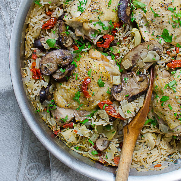 One Pan Mediterranean Chicken with wooden spoon