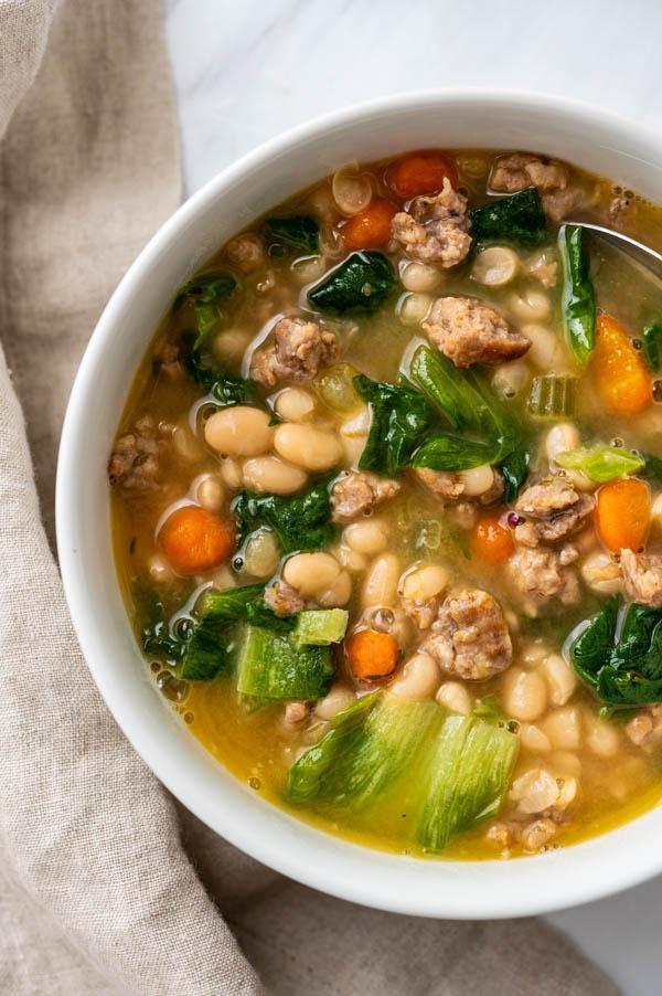 A hearty bowl of sausage escarole white bean soup.