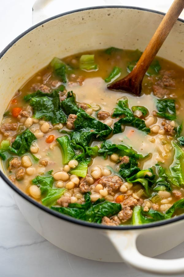 a pot of sausage, white beans and  escarole soup.