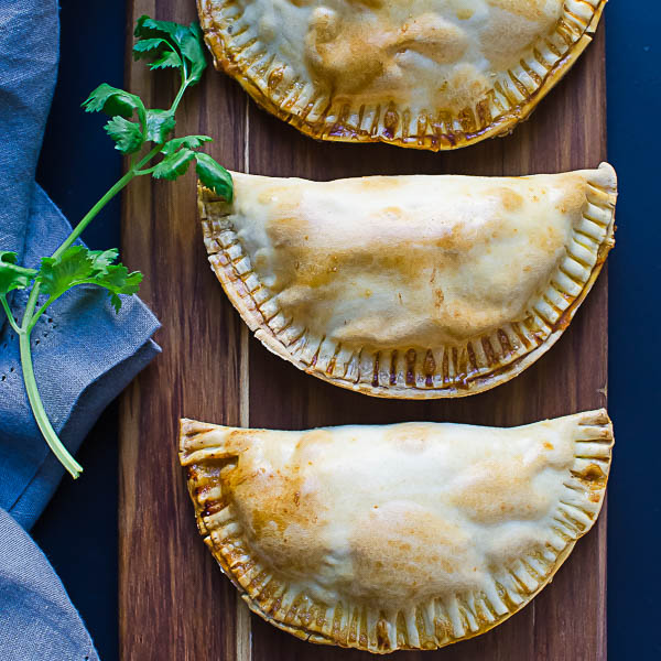 empanadas on serving board