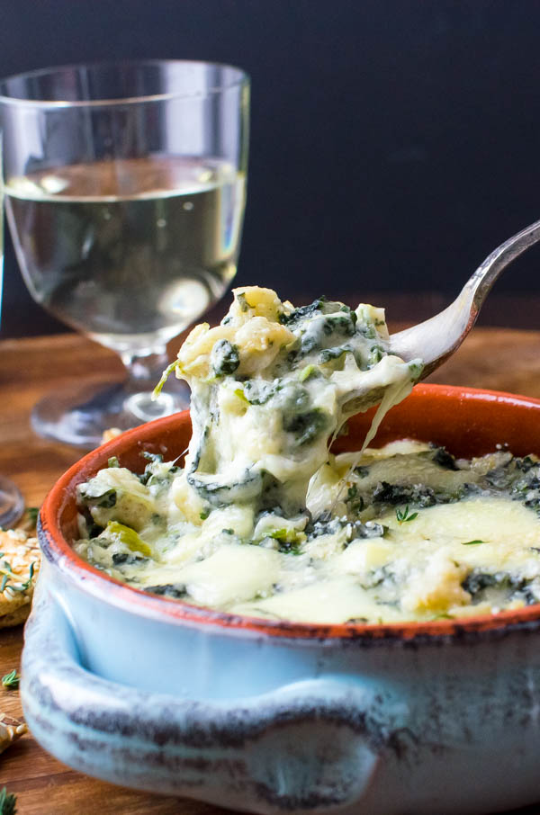 Scooping Cheesy Spinach Artichoke Dip