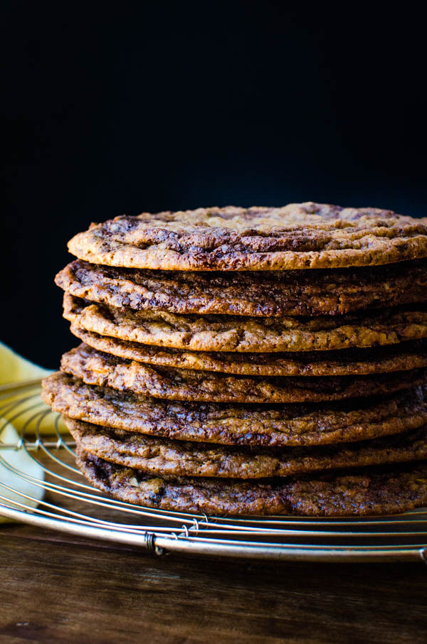 A stack of giant chocolate chip cookies.
