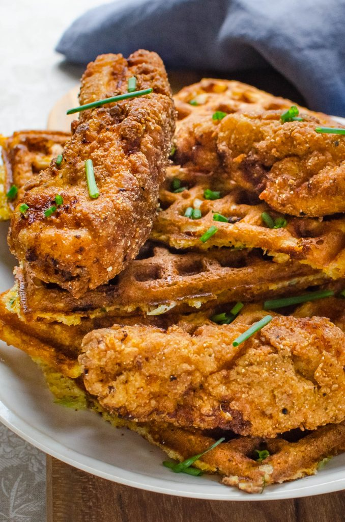 a stack of fried chicken and crispy waffles.