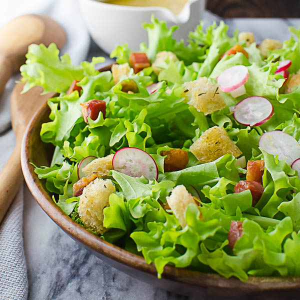 Adding Croutons and Lardons to Tangy Frisee Lardons Salad