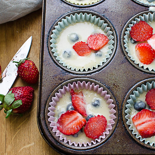 adding strawberries to Individual Berry Streusel Coffeecakes