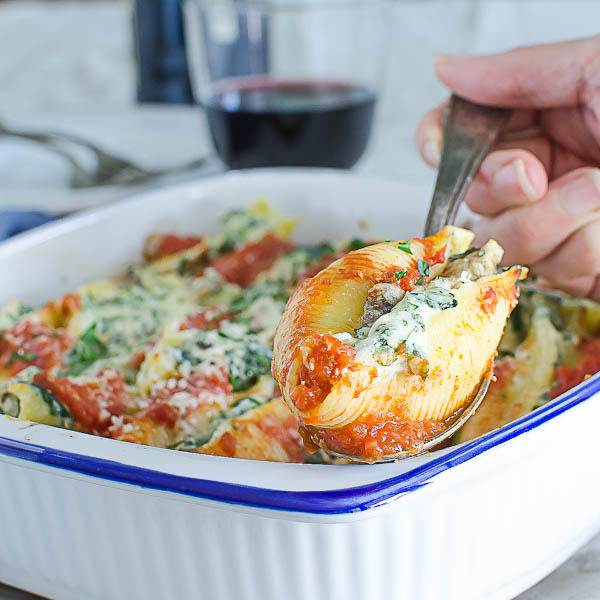 Spooning out Mushroom Kale Stuffed Shells