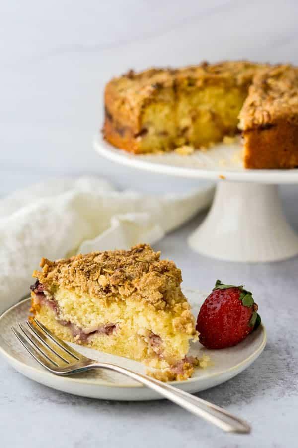 A slice of the moist lemon strawberry coffee cake on a plate.