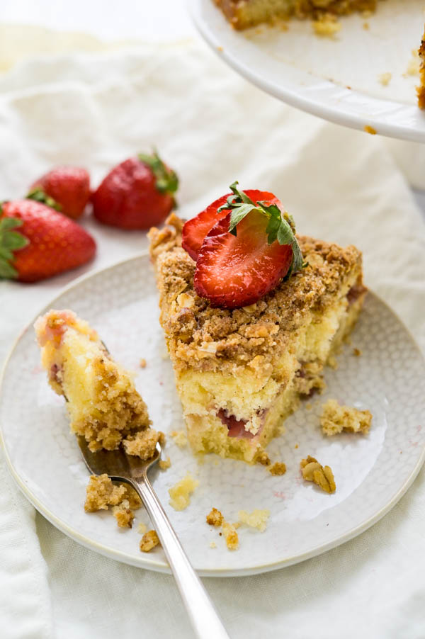 taking a bite of the strawberry lemon crumble coffee cake.