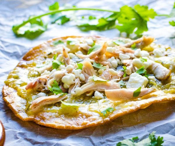 Famous Mexican Food: Authentic Mexican Chalupas with shredded chicken and queso fresco.