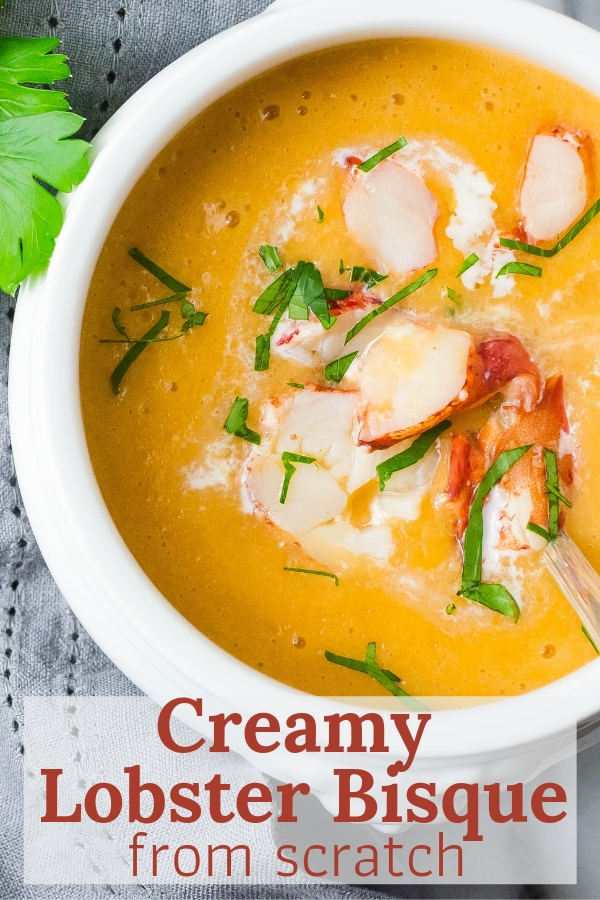 This Creamy Lobster Bisque From Scratch is silky and complex without all the excess cream. A hint of sherry & chunks of lobster make it a special start to a meal! #lobster #lobsterbisque #blendersoup