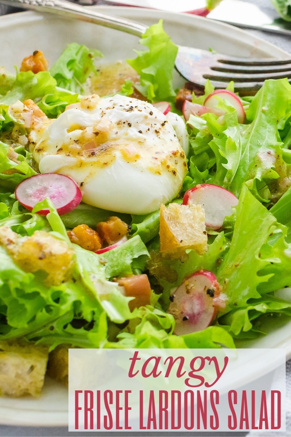 Tangy Frisee Lardons Salad is what every salad aspires to be, topped with a poached egg and tangy vinaigrette. Makes a delicious lunch or light dinner. #ad #friseesalad #poachedegg