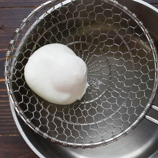 poaching eggs for Spicy Chorizo Hash.