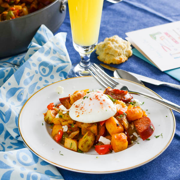 Spicy Chorizo Hash with mimosas.