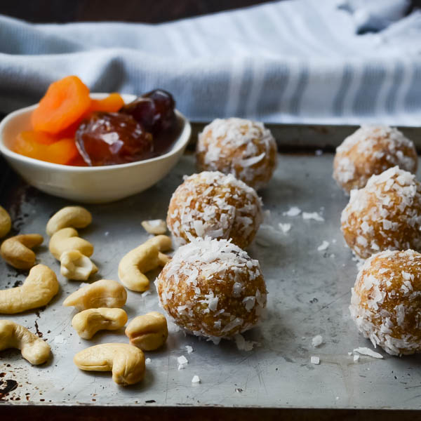 Apricot Date Nut Bites wish cashews on a baking sheet