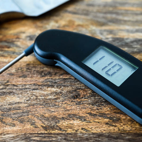 Thermapen Instant Read Thermometer for measuring internal temperature of grilled chicken thighs.