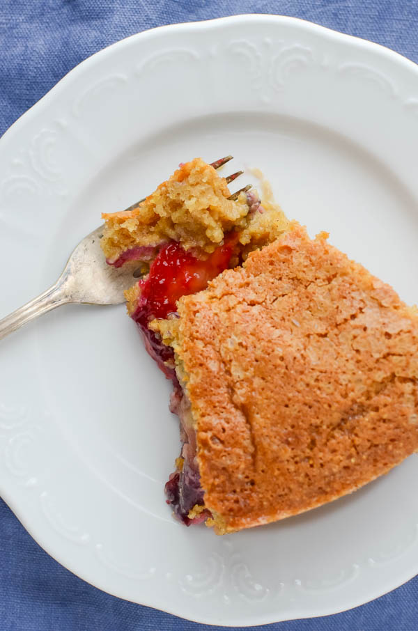 Brown Sugar Cornmeal Plum Cake on plate with fork.
