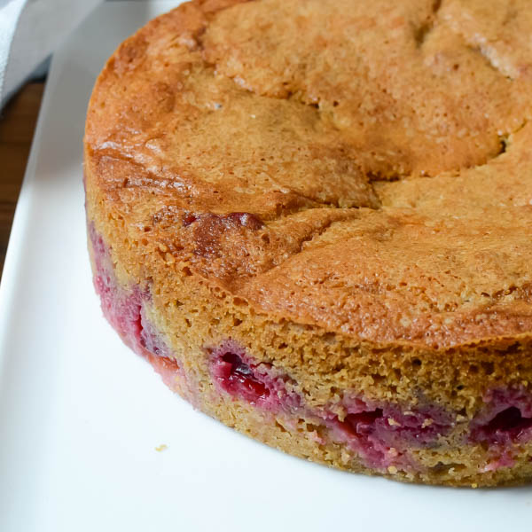 Brown Sugar Cornmeal Plum Cake on cake plate.