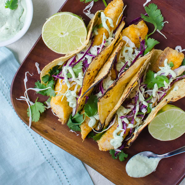 Crispy Baked Fish Tacos with cilantro, lime and crema.