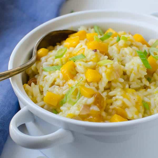 Creamy Coconut Mango Rice with silver spoon