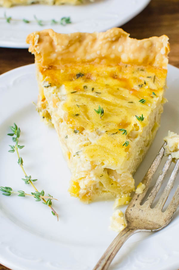 A slice of caramelized onion thyme quiche