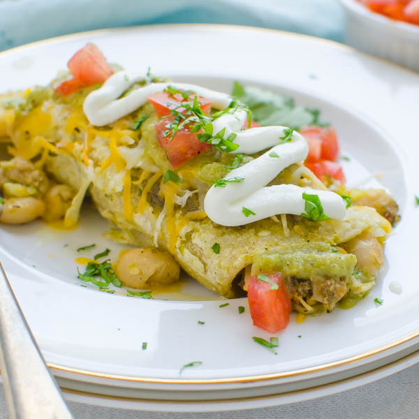 Pork Chile White Bean Enchiladas with sour cream