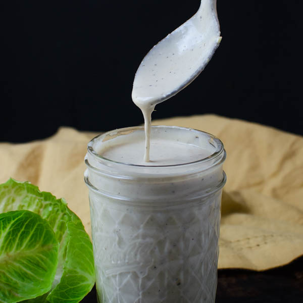 Creamy Parmesan Buttermilk Dressing on a spoon