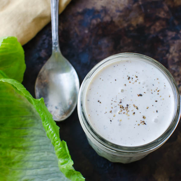 Creamy Parmesan Buttermilk Dressing with lettuce leaf